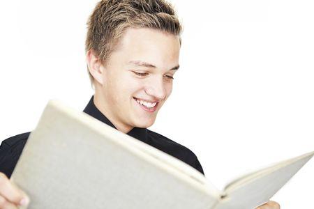 A young boy reading a big book.