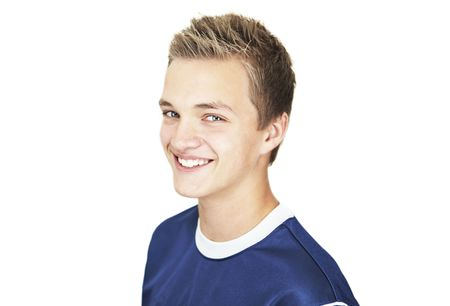 A Cheerful 16 year old boy on a white background Stock Photo