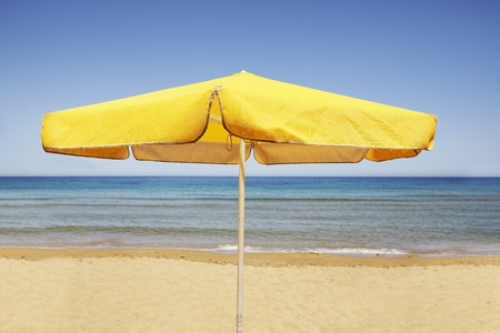yellow sun umbrella on  a  Beach