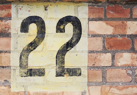 number 22 painted on a brick wall  Stock Photo