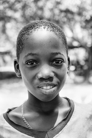 PORTO-NOVO, BENIN - MAR 8, 2012: Portrait of unidentified Beninese beautiful girl. People of Benin suffer of poverty due to the difficult economic situation. Editorial