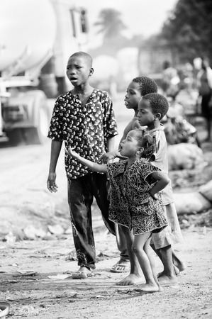 third age: PORTO-NOVO, BENIN - MAR 8, 2012: Unidentified Beninese children in the street. People of Benin suffer of poverty due to the difficult economic situation.
