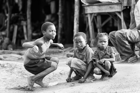 third eye: PORTO-NOVO, BENIN - MAR 8, 2012: Unidentified Beninese little children pose for the camera. People of Benin suffer of poverty due to the difficult economic situation. Editorial