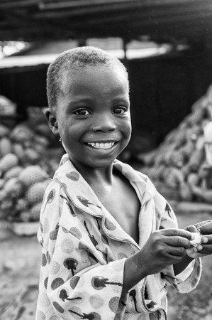 unicef: PORTO-NOVO, BENIN - MAR 8, 2012: Unidentified Beninese little boy portrait. People of Benin suffer of poverty due to the difficult economic situation.