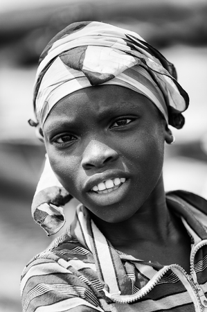 PORTO-NOVO, BENIN - MAR 9, 2012: Unidentified Beninese  smiling woman. People of Benin suffer of poverty due to the difficult economic situation.