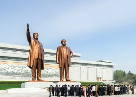 translates: PYONGYANG, NORTH KOREA - MAY 1, 2012: Monument in the center of Pyongyang, North Korea.  Its the capital of North Korea and translates as the Flat Land or Peaceful Land Editorial