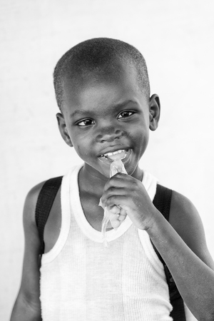 ploblem: KARA, TOGO - MAR 9, 2013: Unidentified Togolese boy portrait. Children in Togo suffer of poverty due to the unstable econimic situation