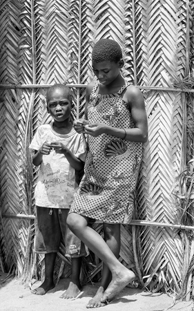 ploblem: KARA, TOGO - MAR 9, 2013: Unidentified Togolese boy and girl stay in the street. Children in Togo suffer of poverty due to the unstable econimic situation
