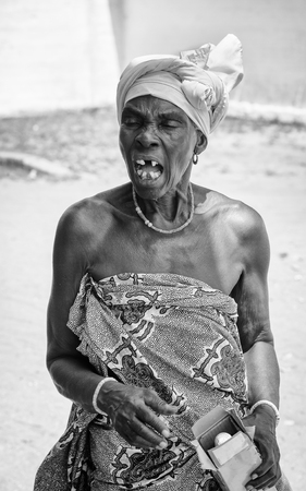 ploblem: KARA, TOGO - MAR 9, 2013: Unidentified Togolese angry woman creams. People in Togo suffer of poverty due to the unstable econimic situation