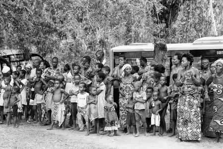ploblem: KARA, TOGO - MAR 9, 2013: Unidentified Togoles children watch a local show. People in Togo suffer of poverty due to the unstable econimic situation Editorial