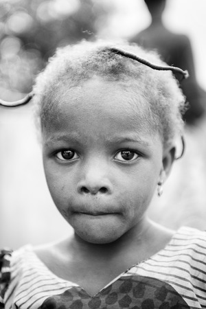 difficult lives: KARA, TOGO - MAR 9, 2013: Unidentified Togolese cute girl portrait. Children in Togo suffer of poverty due to the unstable econimic situation