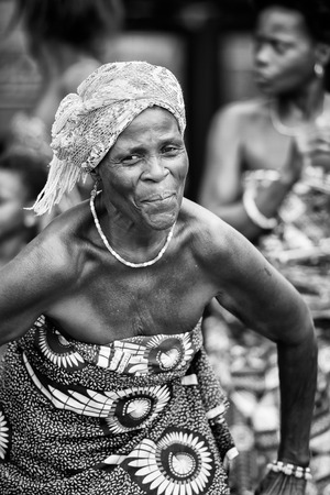 ploblem: KARA, TOGO - MAR 9, 2013: Unidentified Togolese woman dances a local dance. People in Togo suffer of poverty due to the unstable econimic situation Editorial