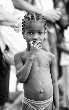 ploblem: KARA, TOGO - MAR 9, 2013: Unidentified Togolese girl portrait in the street. Children in Togo suffer of poverty due to the unstable econimic situation Editorial