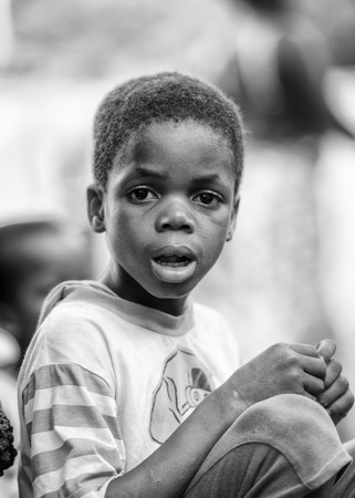 ploblem: KARA, TOGO - MAR 9, 2013: Unidentified Togolese boy with sad eyes. Children in Togo suffer of poverty due to the unstable econimic situation Editorial