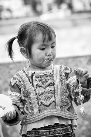 SAPA, VIETMAN - SEP 22, 2014: Unidentified Hmong beautiful girl in Sapa, Vietnam. Hmong is a minority ethnic group of Vietnam