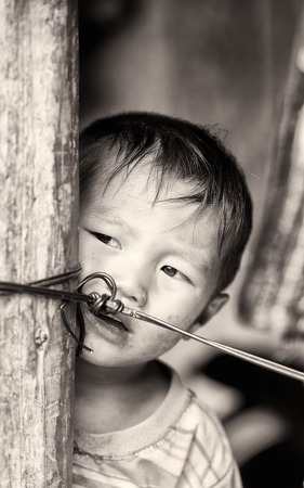 CATCAT VILLAGE, VIETMAN - SEP 12, 2014: Unidentified Vietnamese boy portrait in the Catcat village, Vietnam. 86 of Vietnamese people belong to the Viet ethnic group Editorial