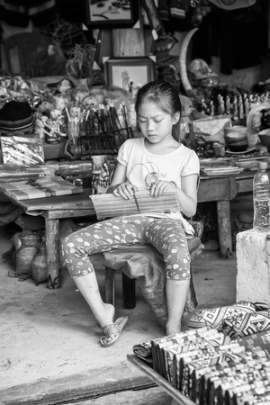 sapa: SAPA, VIETMAN - SEP 22, 2014: Unidentified Hmong girl sells things in a tent in Sapa, Vietnam. Hmong is a minority ethnic group of Vietnam
