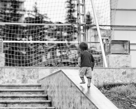 sapa: SAPA, VIETMAN - SEP 22, 2014: Unidentified Hmong little boy goes upstairs in Sapa, Vietnam. Hmong is a minority ethnic group of Vietnam