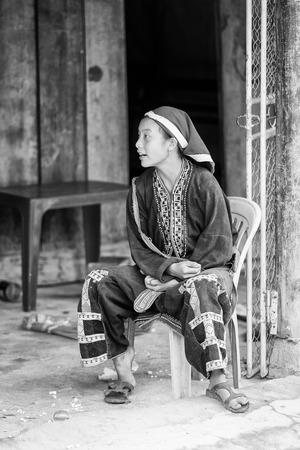 sapa: SAPA, VIETMAN - SEP 22, 2014: Unidentified Hmong woman in a traditional dress in Sapa, Vietnam. Hmong is a minority ethnic group of Vietnam