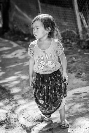 SAPA, VIETMAN - SEP 12, 2014: Unidentified Vietnamese girl portrait in the street in Sapa, Vietnam. 86 of Vietnamese people belong to the Viet ethnic group Editorial