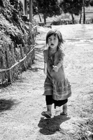 vietnamese ethnicity: SAPA, VIETMAN - SEP 12, 2014: Unidentified Vietnamese girl portrait in the street in Sapa, Vietnam. 86 of Vietnamese people belong to the Viet ethnic group Editorial