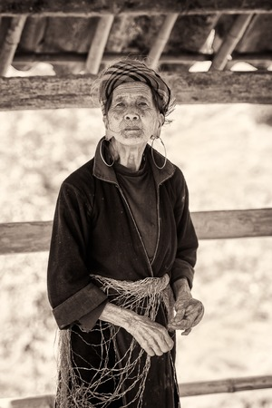 LAO CHAI, VIETMAN - SEP 12, 2014: Unidentified Black Hmong woman in Lao Chai,  Vietnam. Hmong is a ethnic minority group in Vietnam Sajtókép