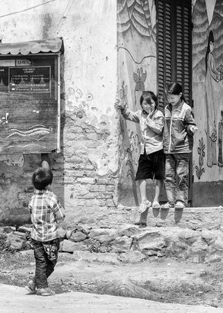 vietnamese ethnicity: LAO CHAI, VIETMAN - SEP 22, 2014: Unidentified Black Hmong boy looks at the girls in Lao Chai, Vietnam. Hmong is a ethnic minority group in Vietnam
