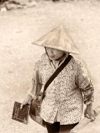 vietnamese ethnicity: LAO CHAI, VIETMAN - SEP 22, 2014: Unidentified Black Hmong man walks in Lao Chai, Vietnam. Hmong is a ethnic minority group in Vietnam