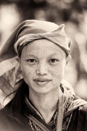 vietnamese ethnicity: SAPAI, VIETMAN - SEP 22, 2014: Unidentified Black Hmong woman portrait in Sapa, Vietnam. Hmong is a ethnic minority group in Vietnam