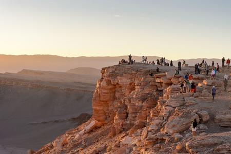kilometres: ATACAMA DESERT, CHILE - NOV 3, 2014: Unidentified tourists making pictures in the Atacama desert, Chile. Atacama Desert proper occupies 105,000 square kilometres Editorial