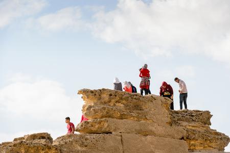 GIZA, EGYPT - NOV 23, 2014: Unidentified Egyptian people at Giza Necropolis, Egypt. UNESCO World Heritage
