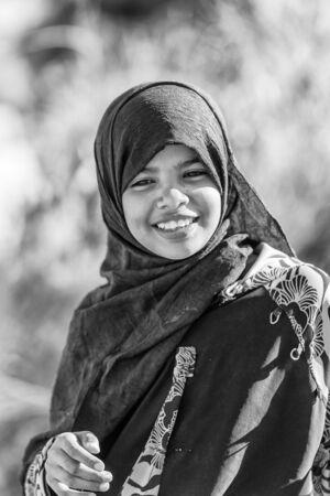 ASWAN, EGYPT - DEC 2, 2014: Unidentified Egyptian girl portrait. 90 of Egyptian people are Muslim