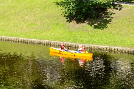 RIGA, LATVIA - SEP 7, 2014: Touristic boat in the Kronvalda park in Riga, Latvia. Park is named after the Latvian linguist Atis Kronvald