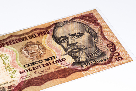 and soles: 5000 soles de oro bank note. Soles de oro is the national currency of Peru