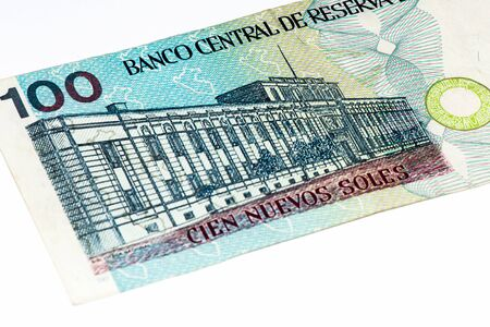 and soles: 100 soles nuevos bank note. Soles nuevos is the national currency of Peru Stock Photo