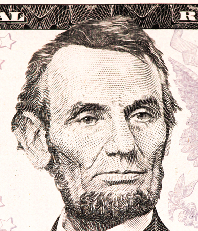 abe: Abe Lincoln portrait on a 5 US dollars banknote made in 2013. Stock Photo