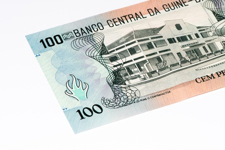 pesos: 100 pesos bank note of Guine Bissau. Peso is the former currency of Guine Bissau