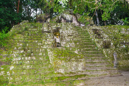Pyramid in Mundo Perdido (Lost World), the largest ceremonial complex dating from the Preclassic period at the ancient Maya city of Tikal, Guatemala Stock Photo