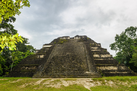 Pyramid of Mundo Perdido, the largest ceremonial complex dating from the Preclassic period at the ancient Maya city of Tikal, northern Guatemala. Stock Photo