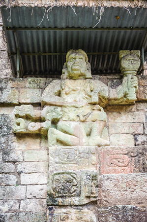 head stones: One of two simian sculptures on Temple 11, Howler Monkey Gods. Copan, Honduras