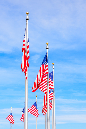 American National flags at the Washington Monument, an obelisk on the National Mall in Washington, D.C. U.S. National Register of Historic Places Stock Photo