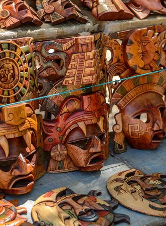 Masks, Authentic handcraft souvenirs of maya civilisation Foto de archivo