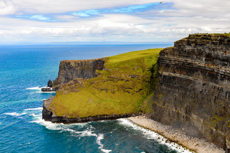 irish countryside: Spectacular view of the Cliffs of Moher (Aillte an Mhothair), edge of the Burren region in County Clare, Ireland. Great touristic attraction