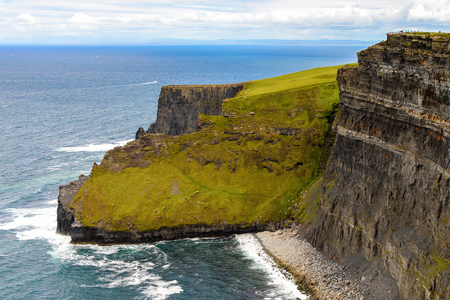 Spectacular view of the Cliffs of Moher (Aillte an Mhothair), edge of the Burren region in County Clare, Ireland. Great touristic attraction