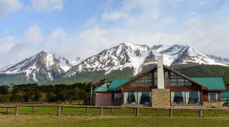 House in front of the snow mountain in Ushuaia, Argentina