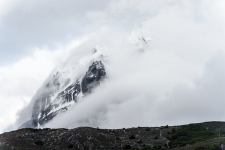 Mountain in snow, mist and clouds