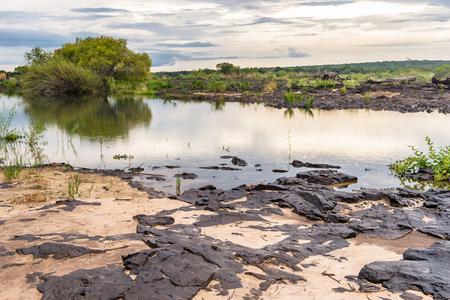 Sunset on the Zambezi river and Livingstone Island, named after the Scottish  explorer David Livingstone