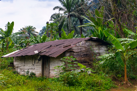 Small poor almost destroyed houses in Africa where people live Stock Photo