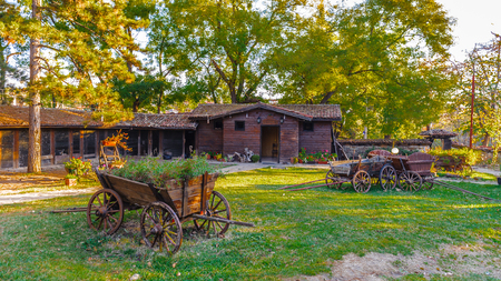 Small wooden decorative carriages in a Bulgarian village Stock Photo