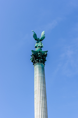 The top of the column depicts Archangel Gabriel, who holds the Hungarian Holy Crown and the apostolic double cross in his hands Stock Photo